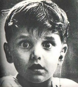 A young boy, Harold Whittles, hears for the first time in his life, after a doctor places an earpiece, 1974.